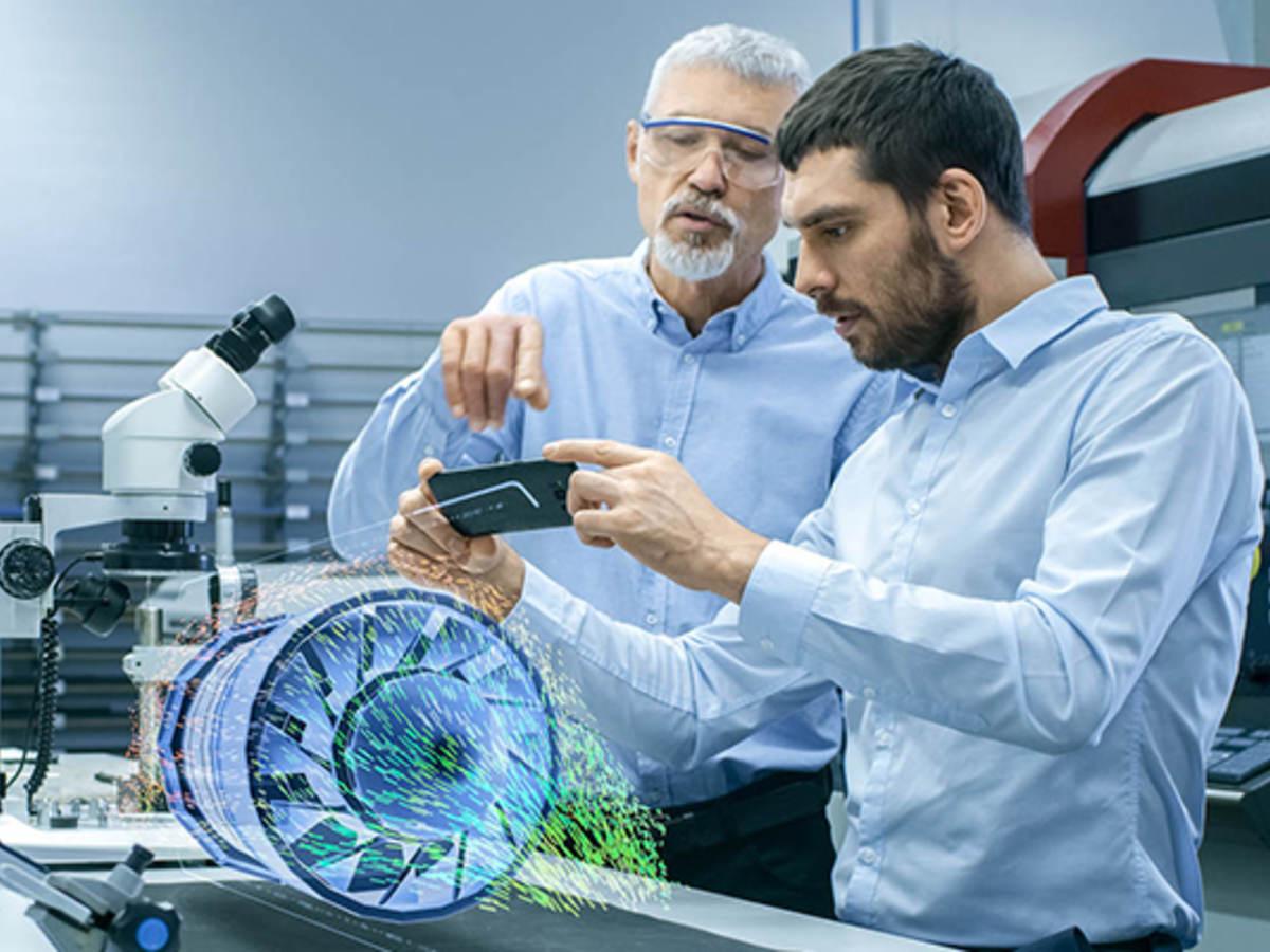 two male laboratory technicians observing a digital model