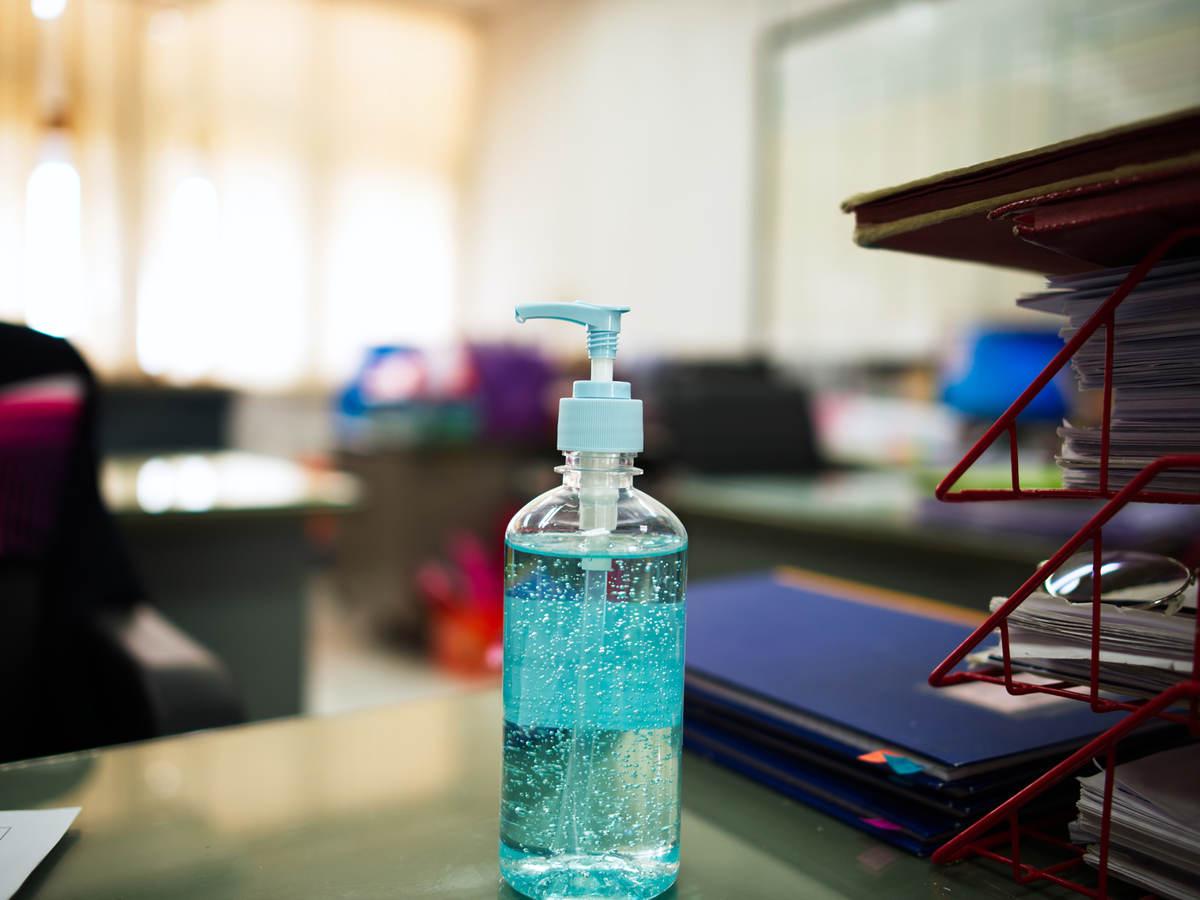 Bottle of hand sanitizing gel on an office desk