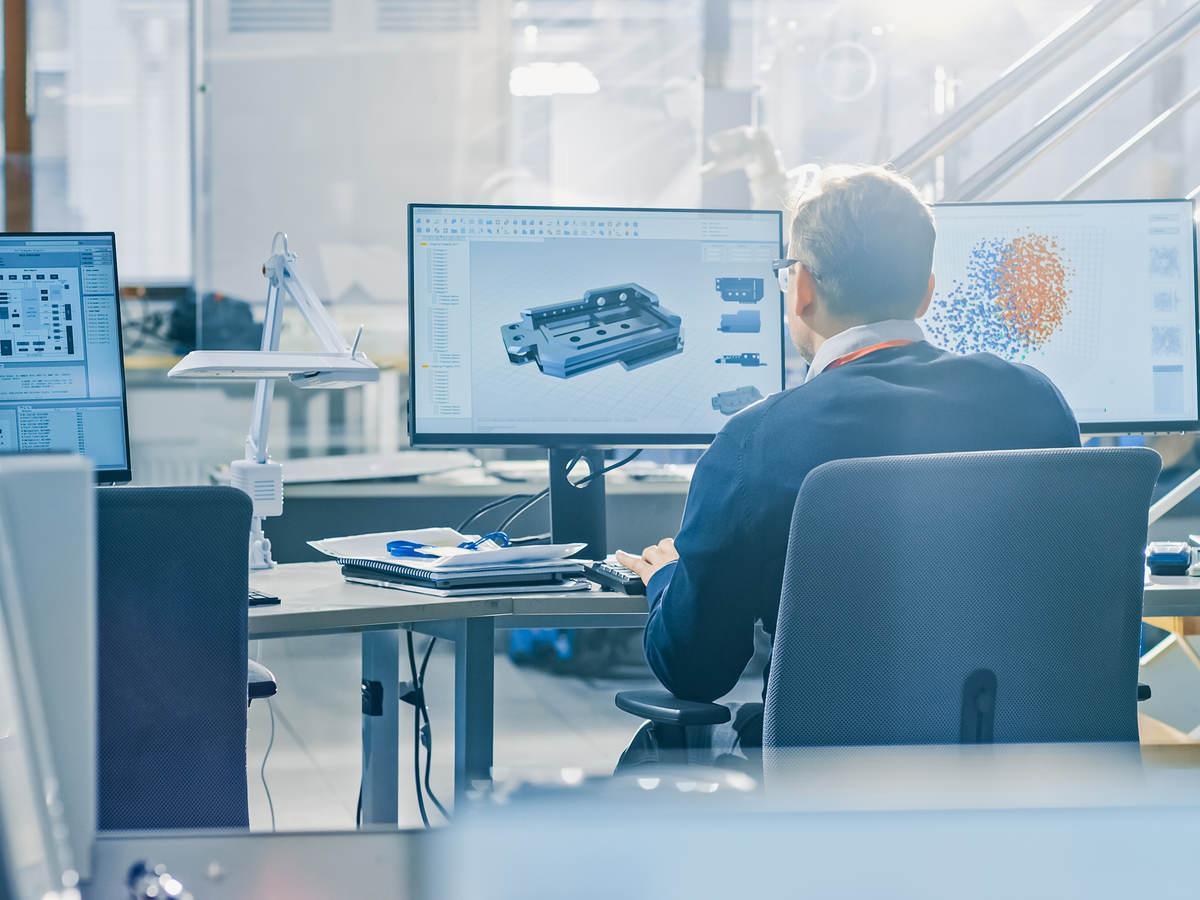 Industrial engineer works on his desktop monitors
