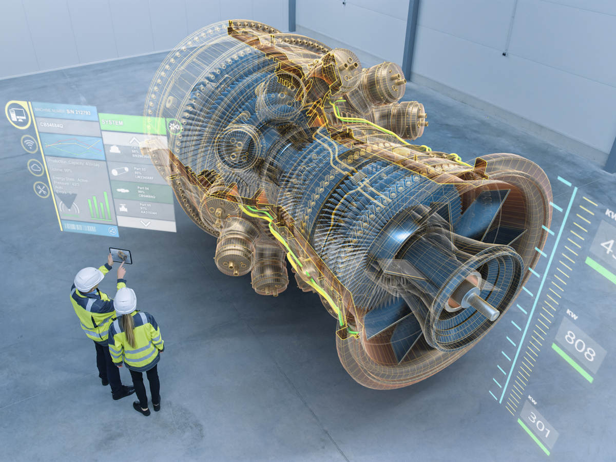 Engineers working with 3D turbine model