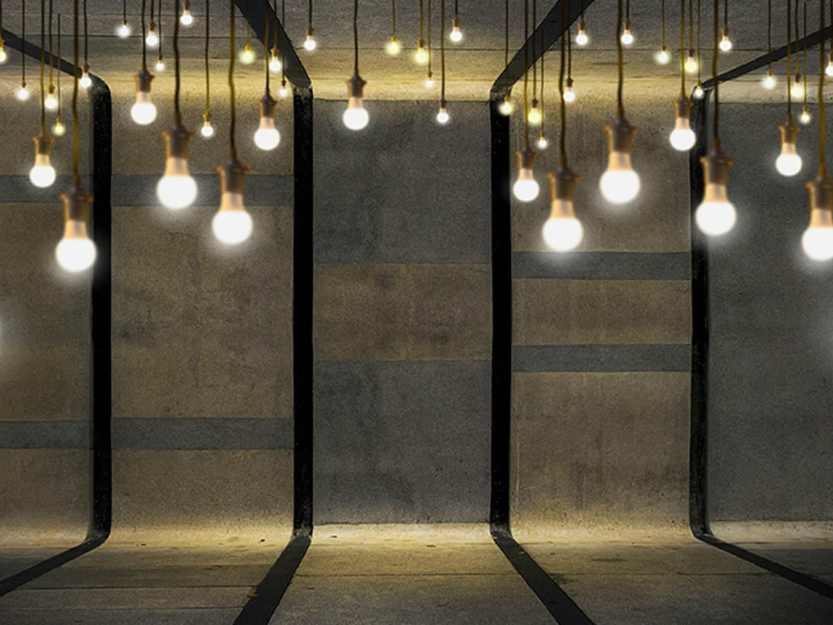Light bulbs hanging in cement room