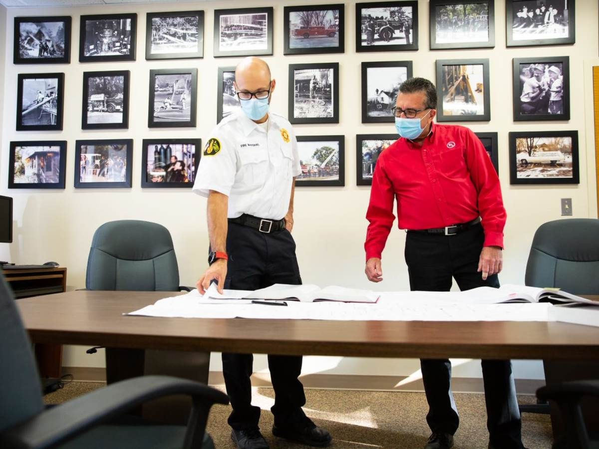 Two code authorities looking at paperwork