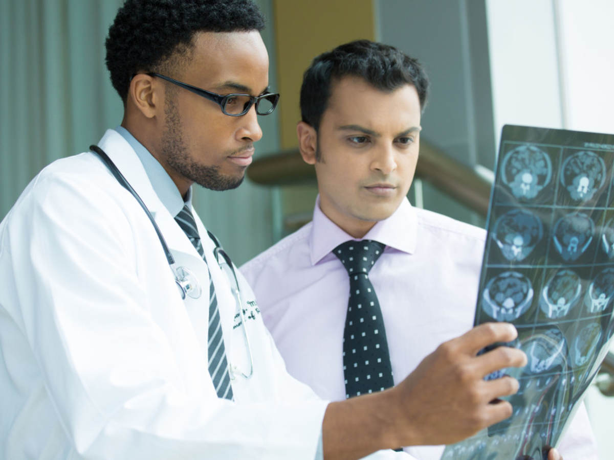 Two doctors examining a brain x-ray