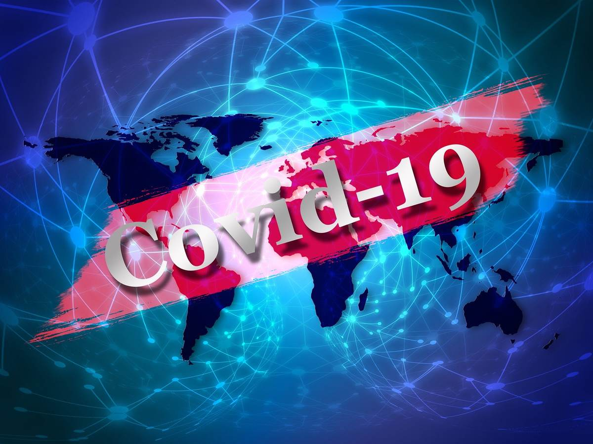 Global view with the word Covid-19 across it.
