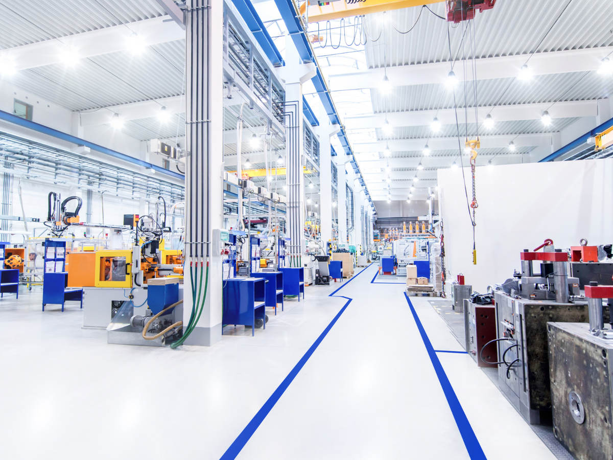 View overlooking the digitally controlled lighting of a brightly lit modern factory floor.