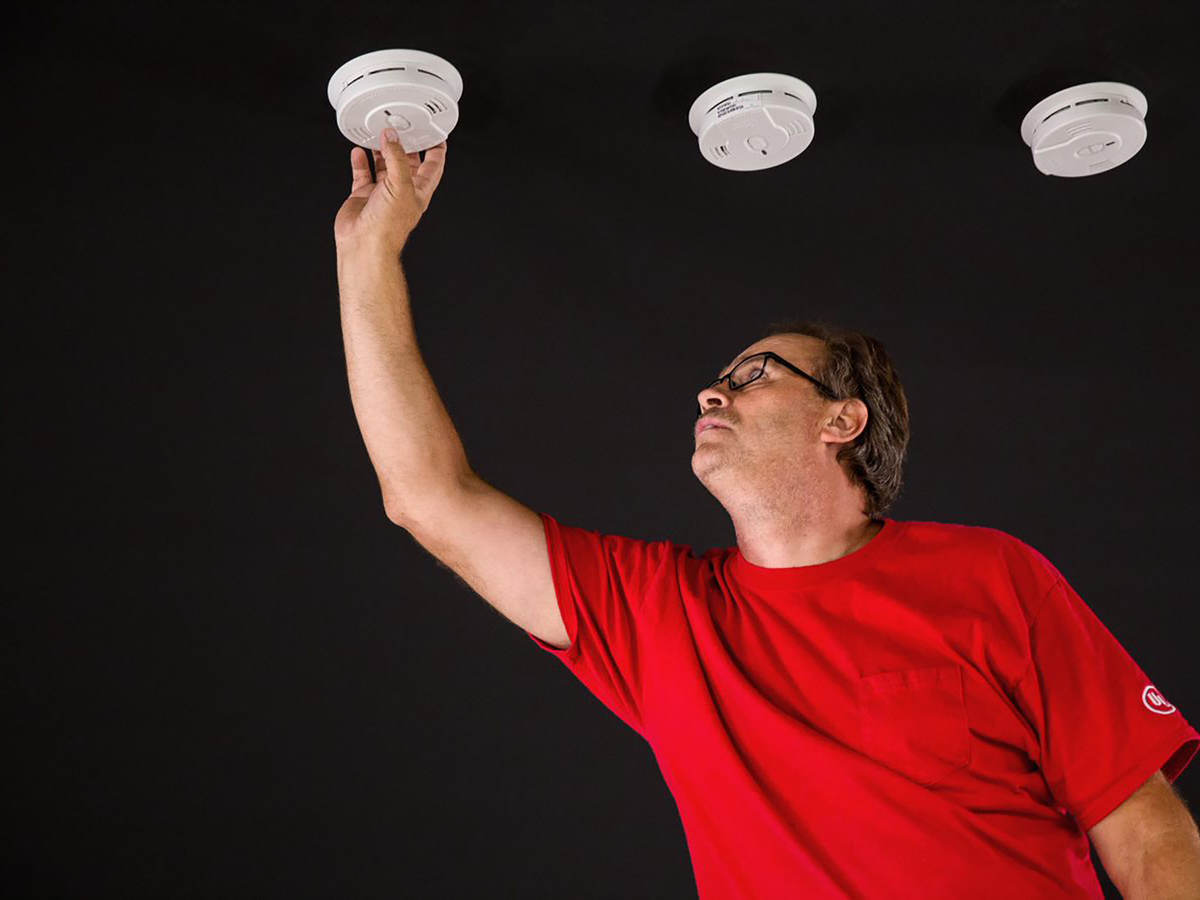UL technician looking at smoke alarms in the laboratory
