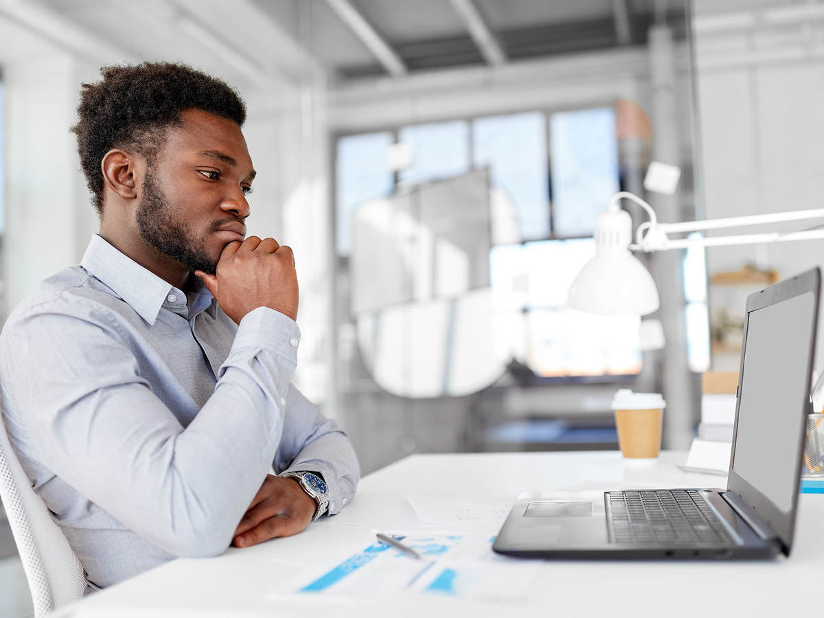 Man sitting in front of computer doing online training