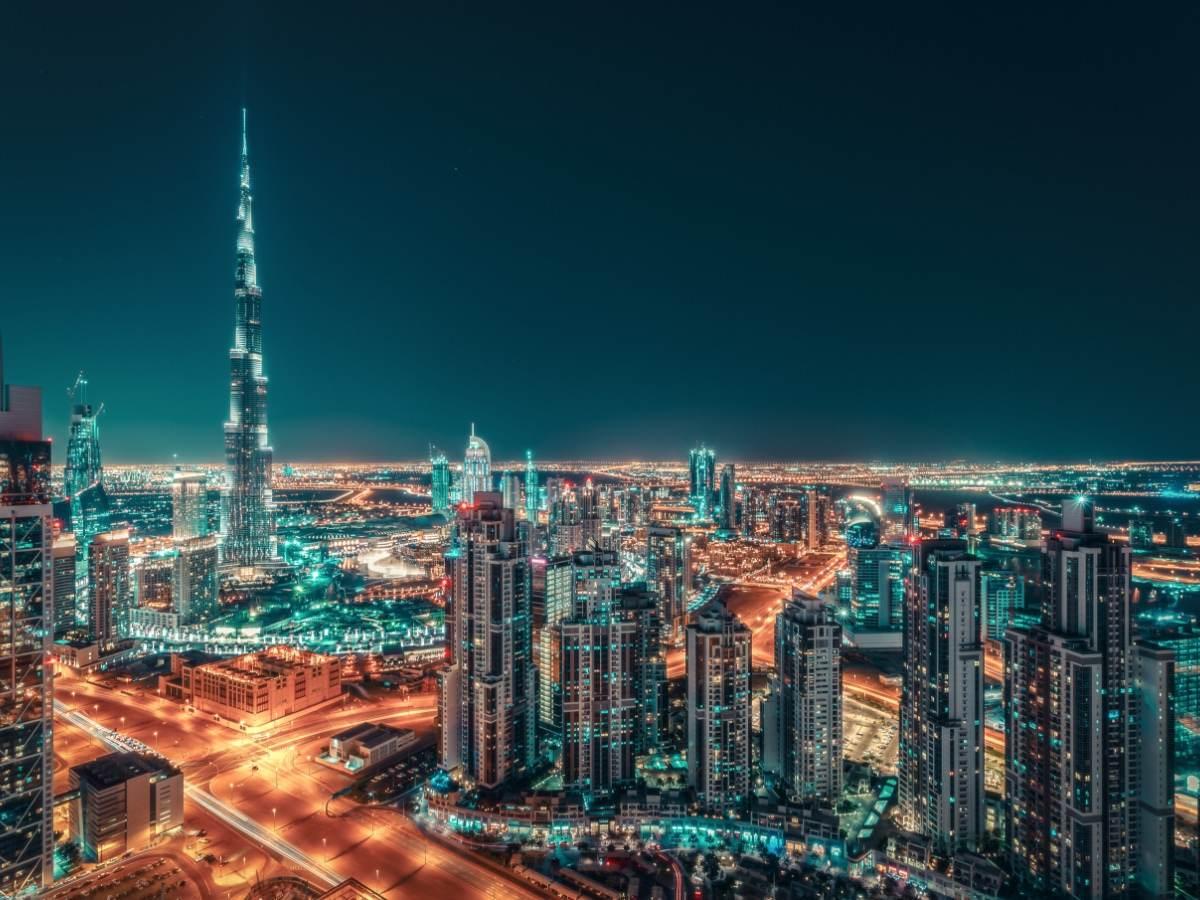 Nighttime skyline of big city illuminated by skyscrapers