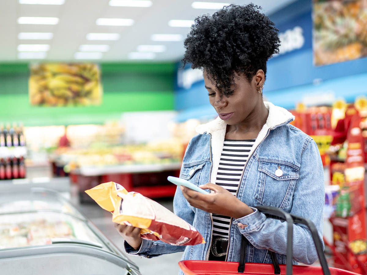 Woman scanning a label at the grocery store