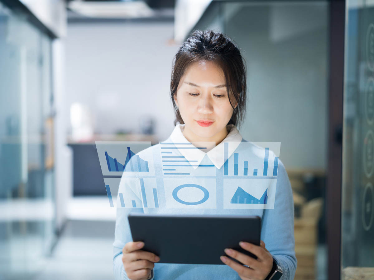 Businesswoman using virtual visual screen