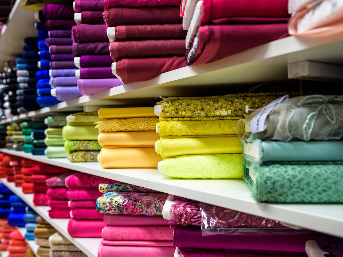 Rolls of brightly colored fabric