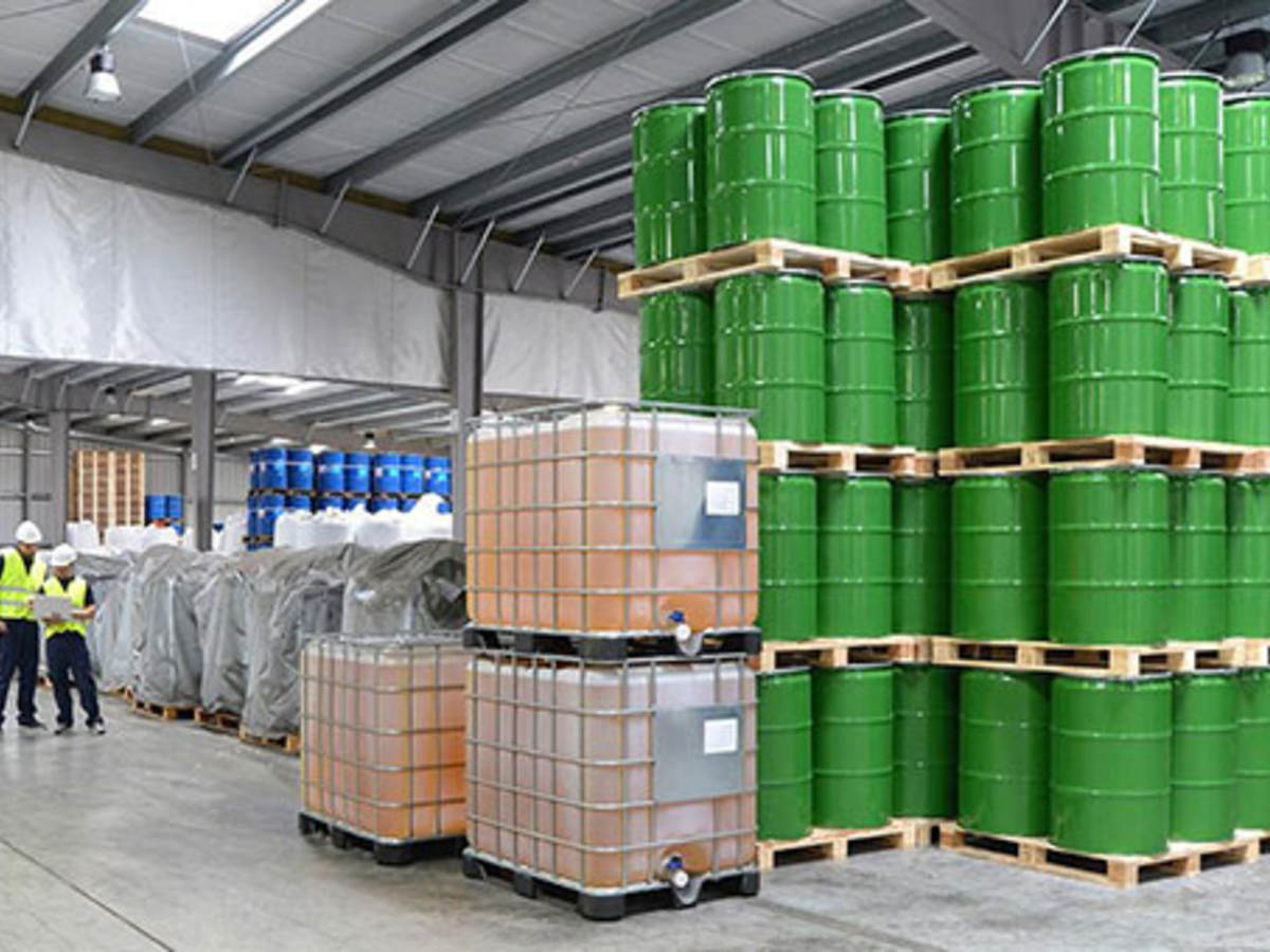 Warehouse with green barrels
