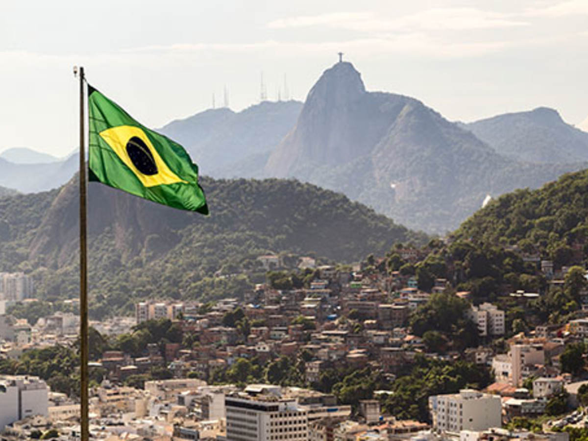 Brazilian flag flying over countryside view