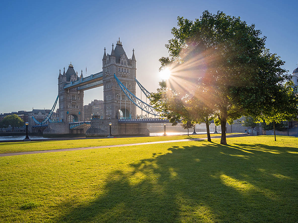 View of London bridge with sun rays in the background.