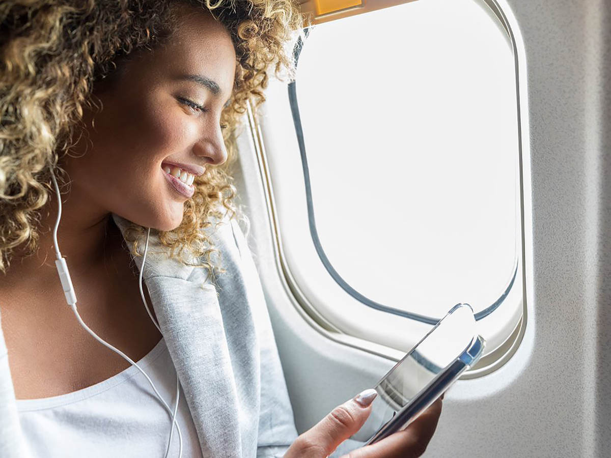 Woman with cell phone on flight