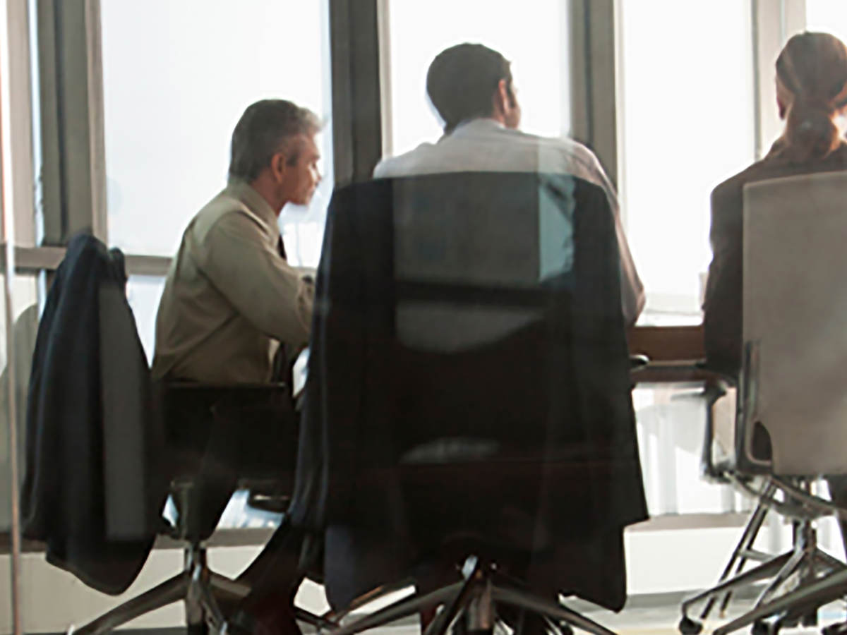 Business people in a modern all glass made meeting room