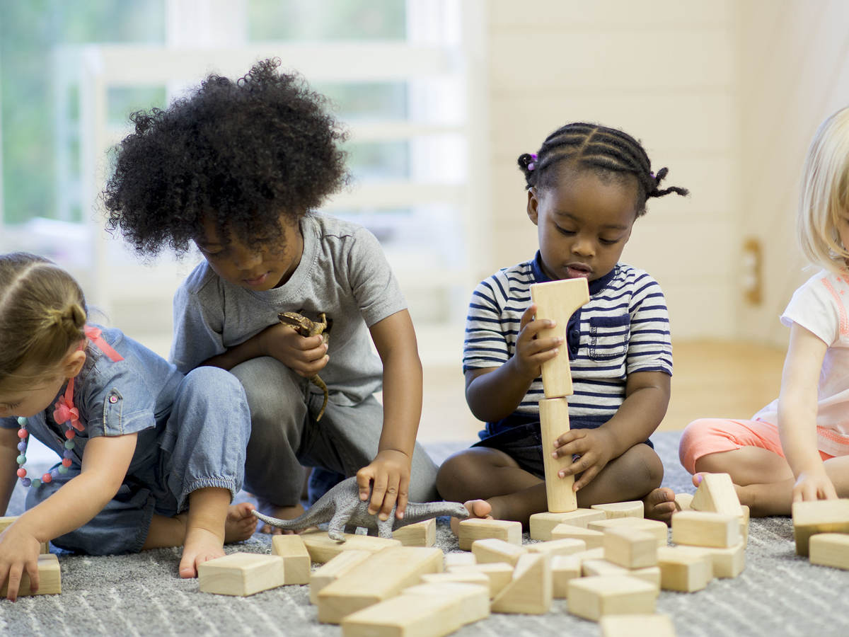Children playing with wood blocks