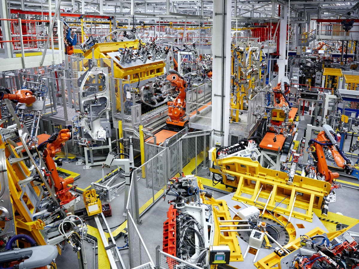Robots putting cars together in a factory