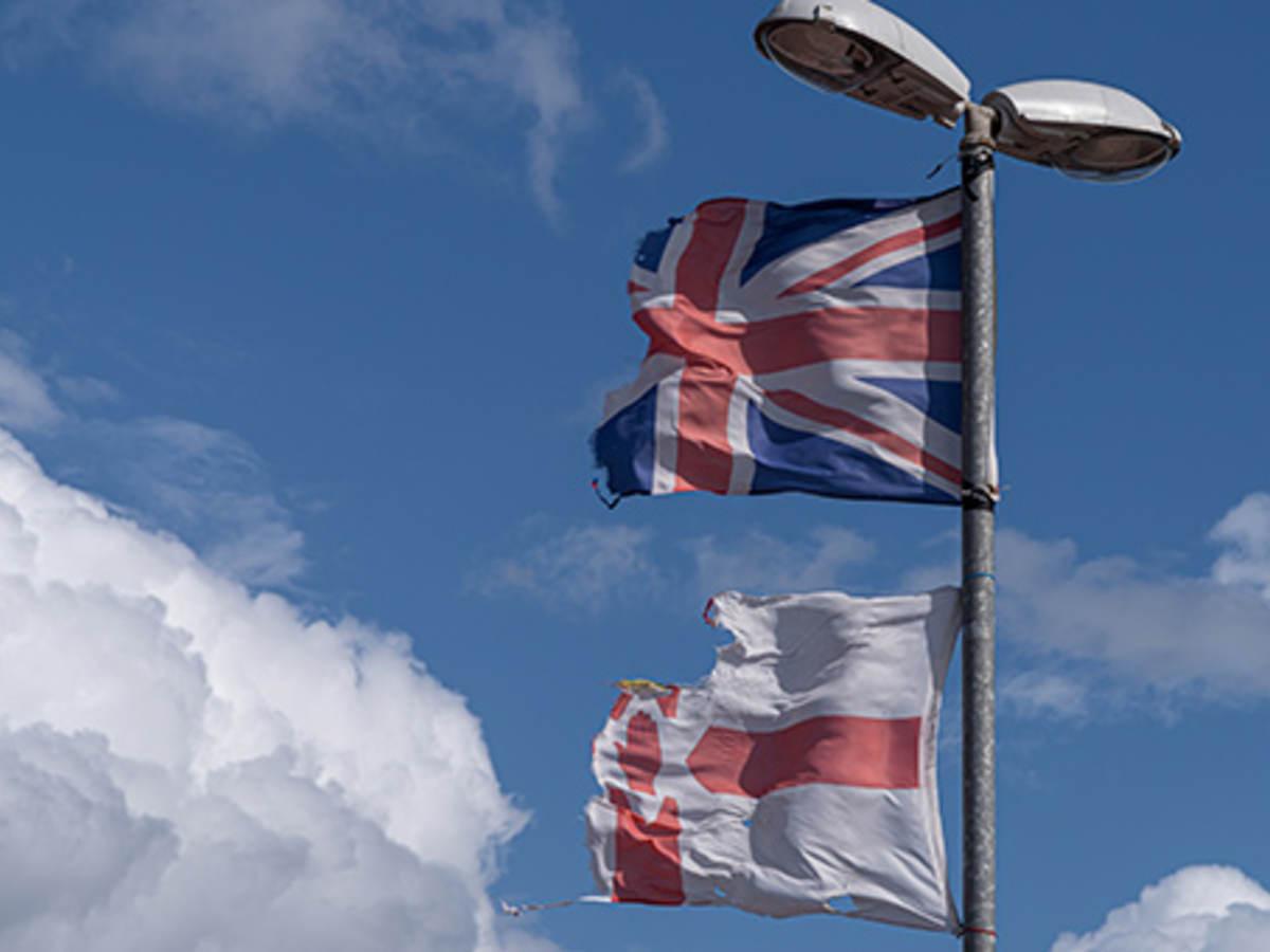 UK flag over the Northern Ireland flag