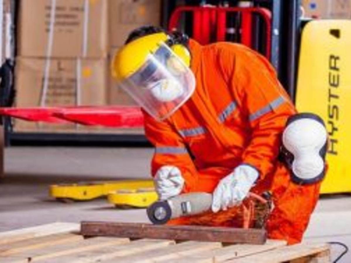 Industrial worker using grinder
