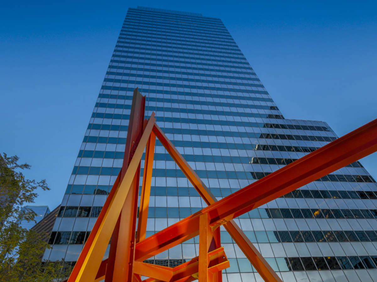 Skyscraper with red sculpture in the foreground