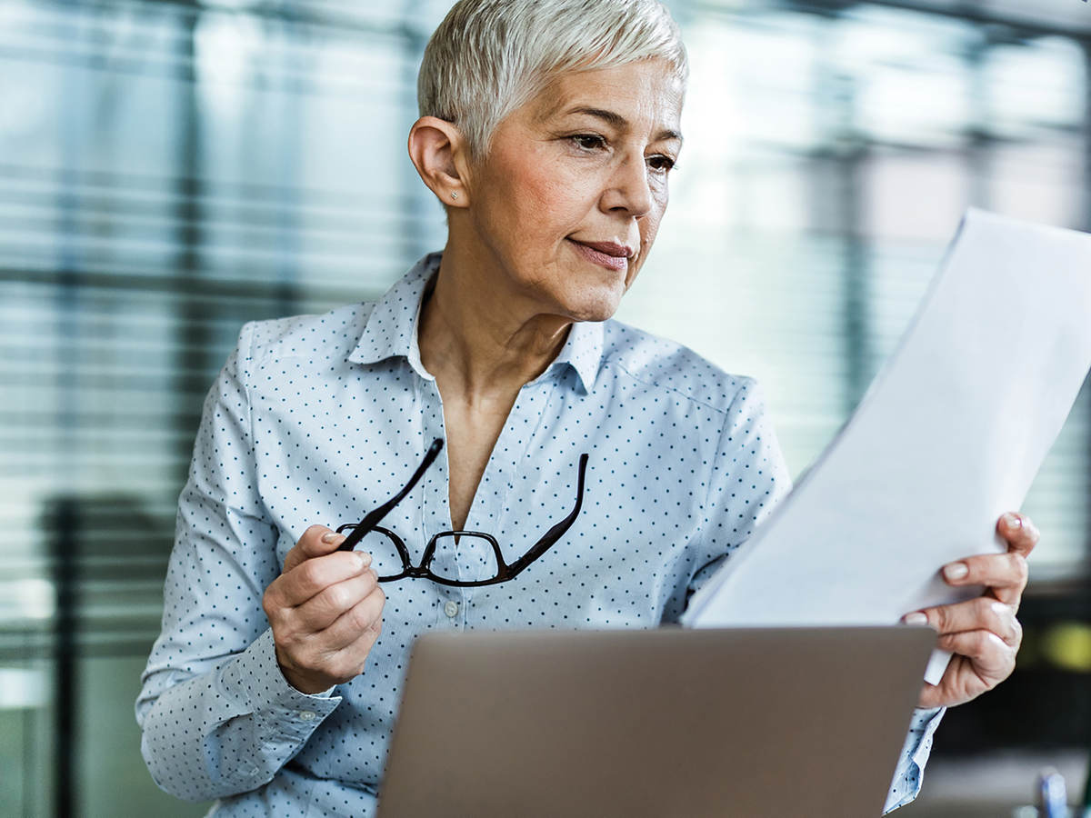 Woman looking at market share documents