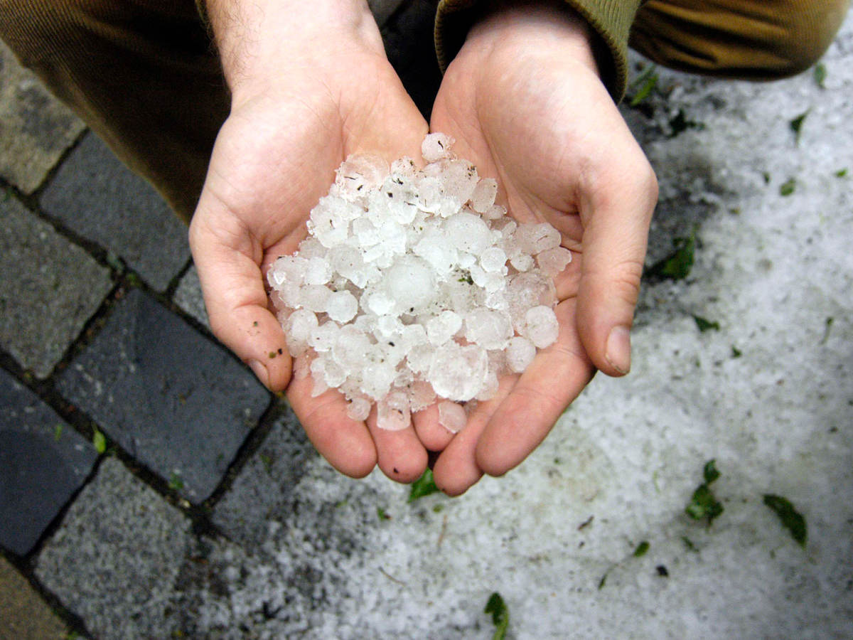 Two hands holding hail stones