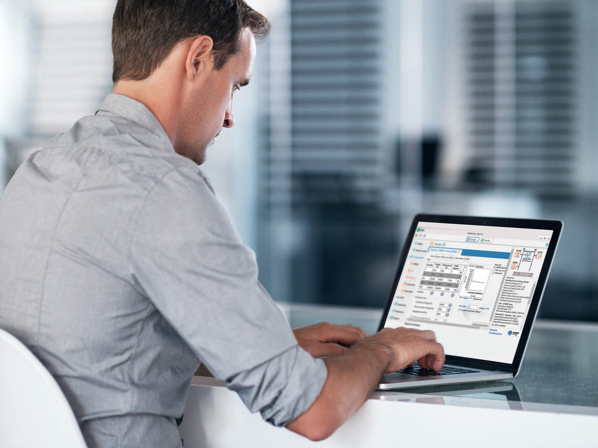 HOMER Grid microgrid software on a laptop with a man seated at a desk.