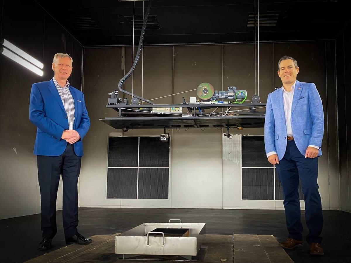 Mark Burgess, director, Infrastructure Technologies and Testing Services, Commonwealth Scientific and Industrial Research Organisation, left, and Matthew Wright, built environment manager for UL in Australasia,right, pose inside a CSIRO test chamber.