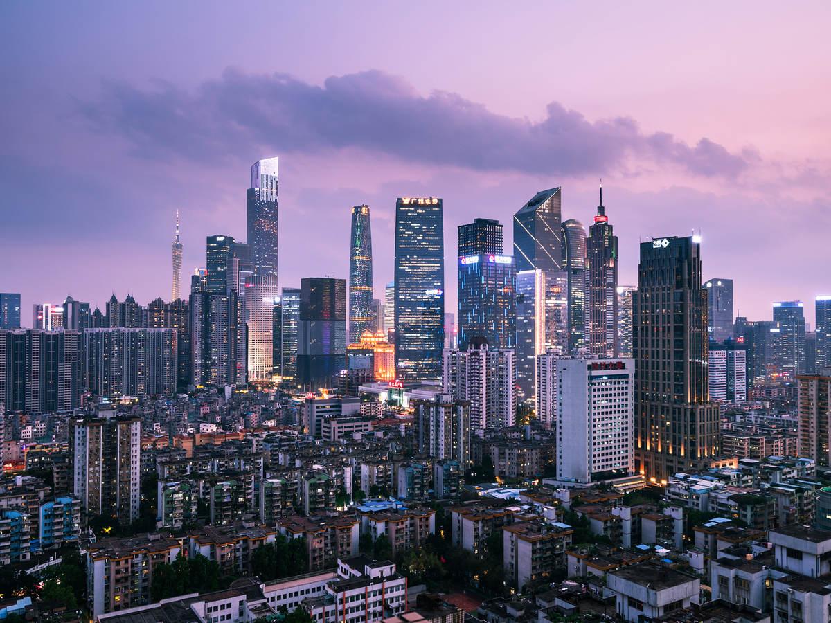 The brightly lit Guangzhou city skyline at night