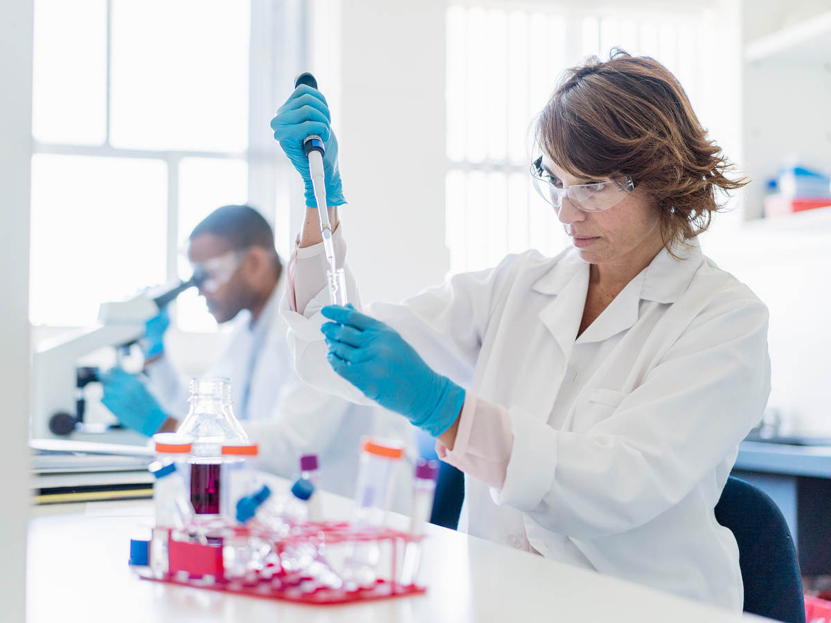 Concentrated chemist working on chemicals