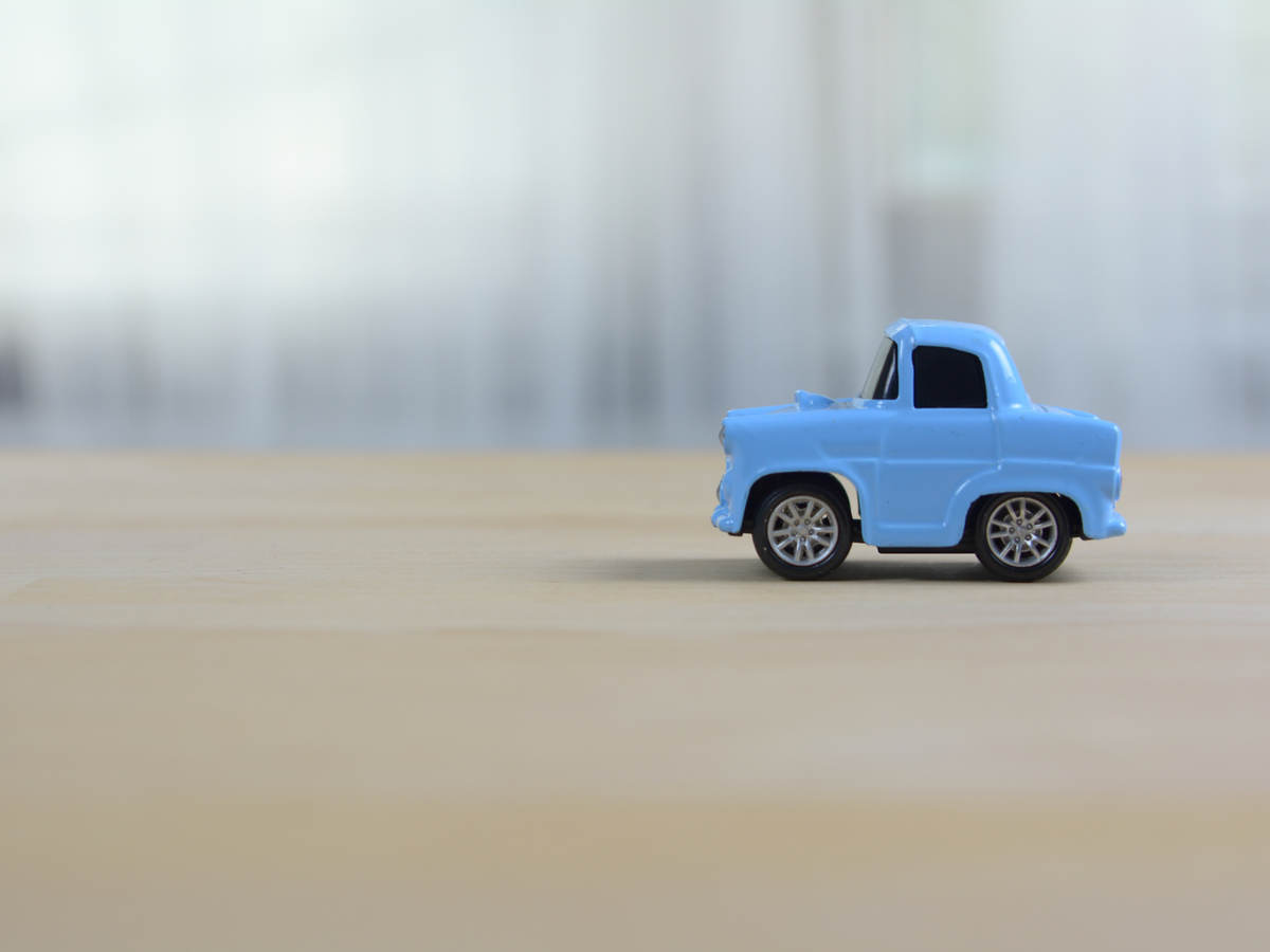 Blue old style toy car on a table