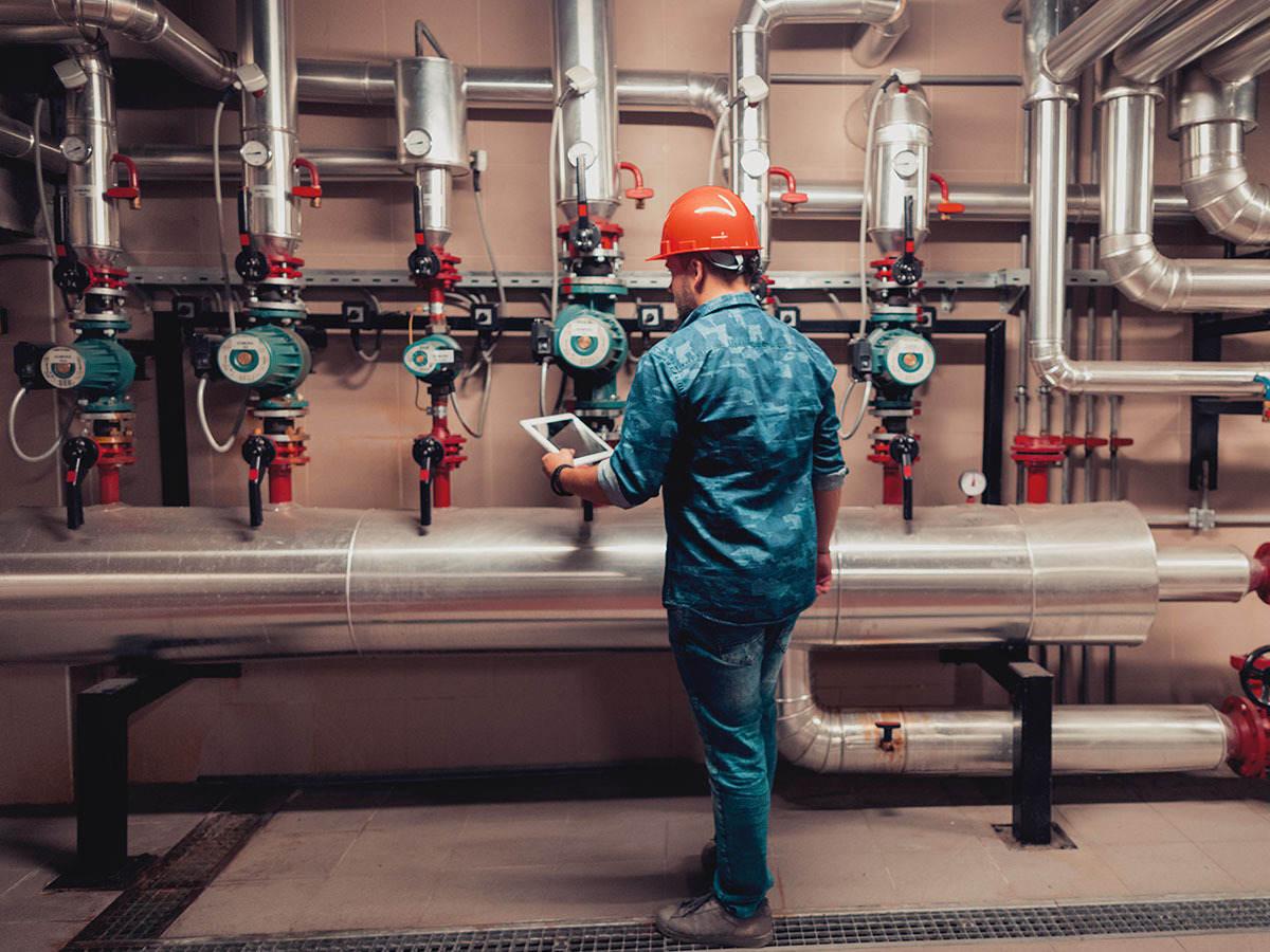 Electrical engineer working in an industrial boiler control room