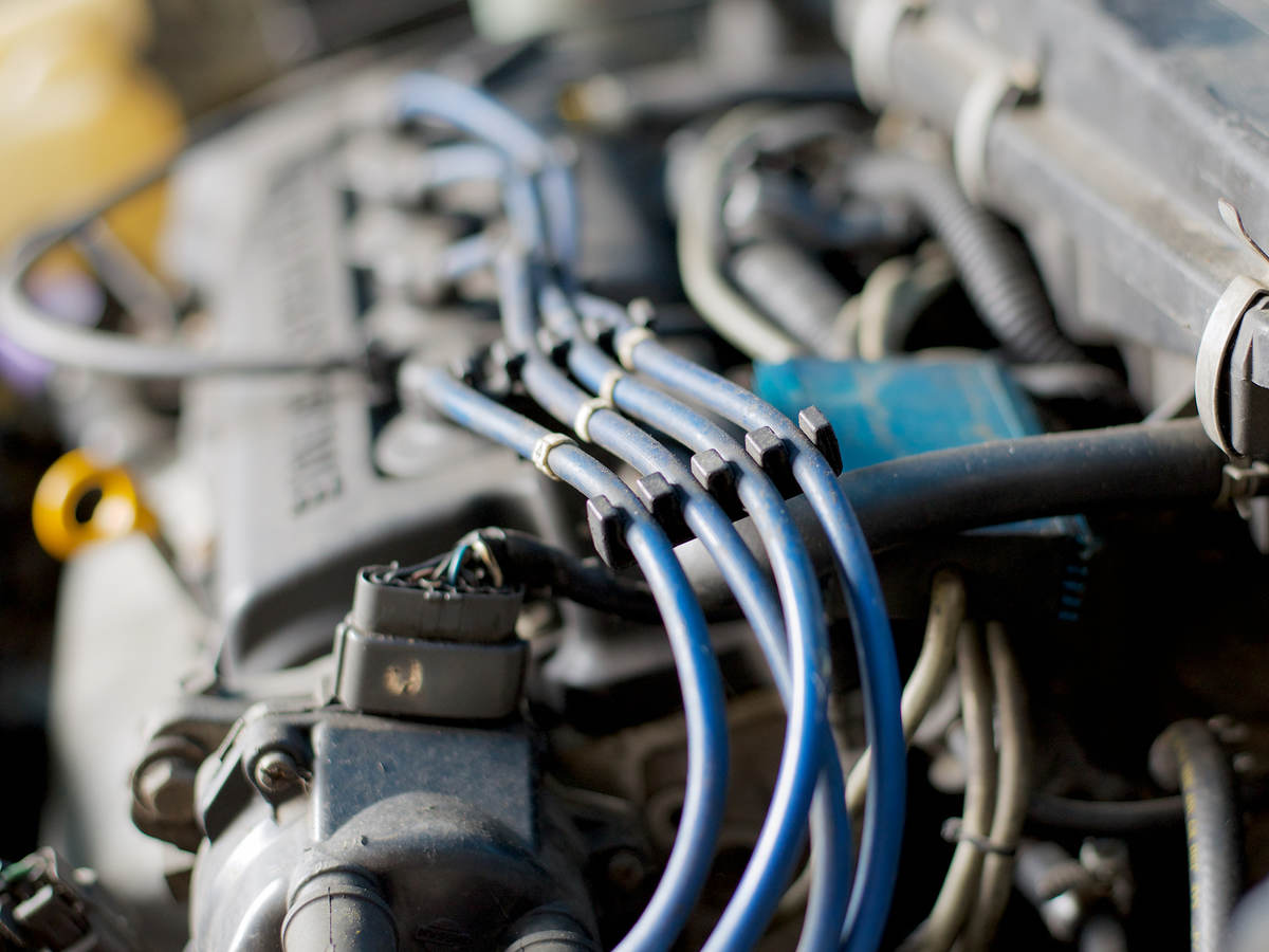 Close-up of car engine showing ignition coil cable wires