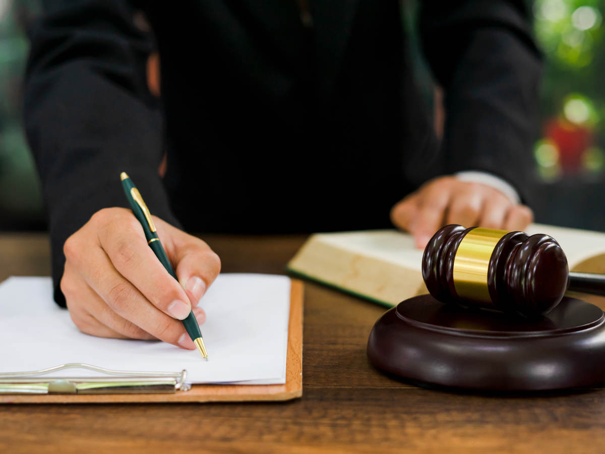 Man signing legal document