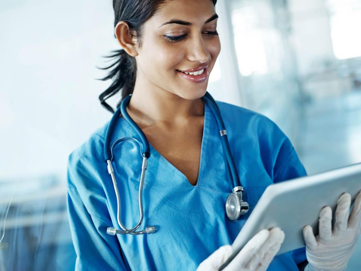 Nurse looking at a tablet
