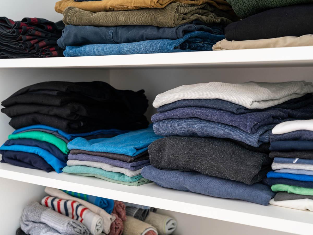 Shelf with folded clothing