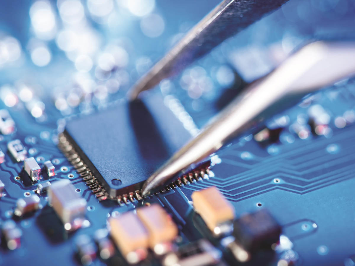 Tweezer being used on a circuit board