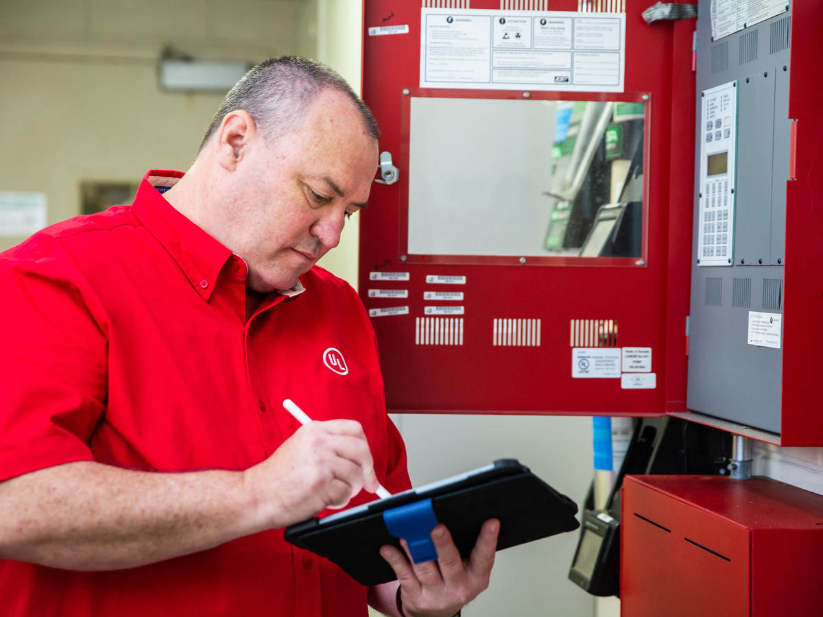 UL employee checking a fire alarm system