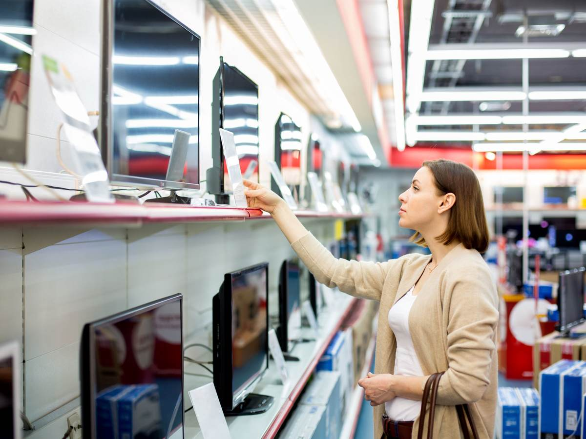 woman buying a TV in a retail store