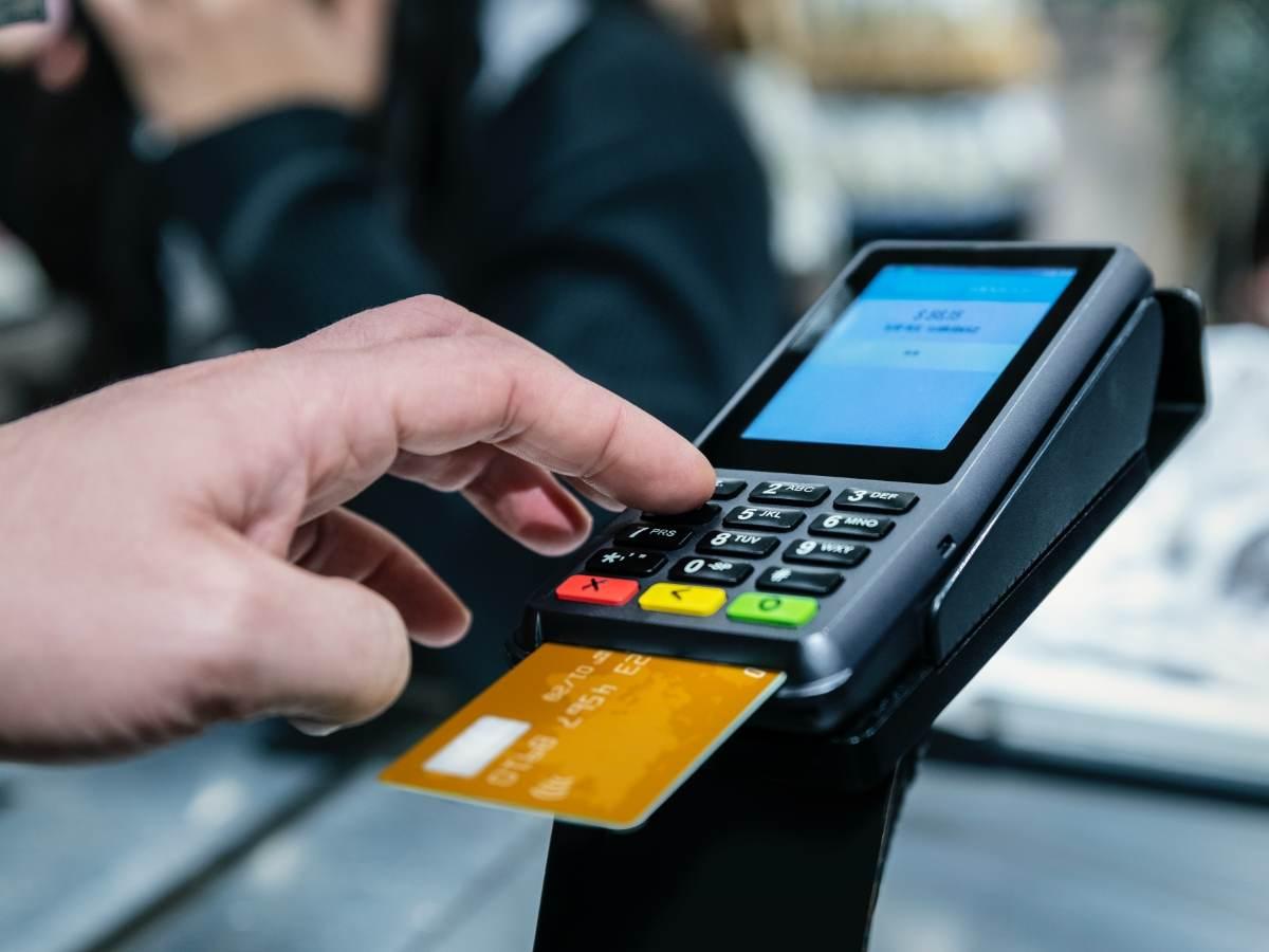 man using a payment terminal