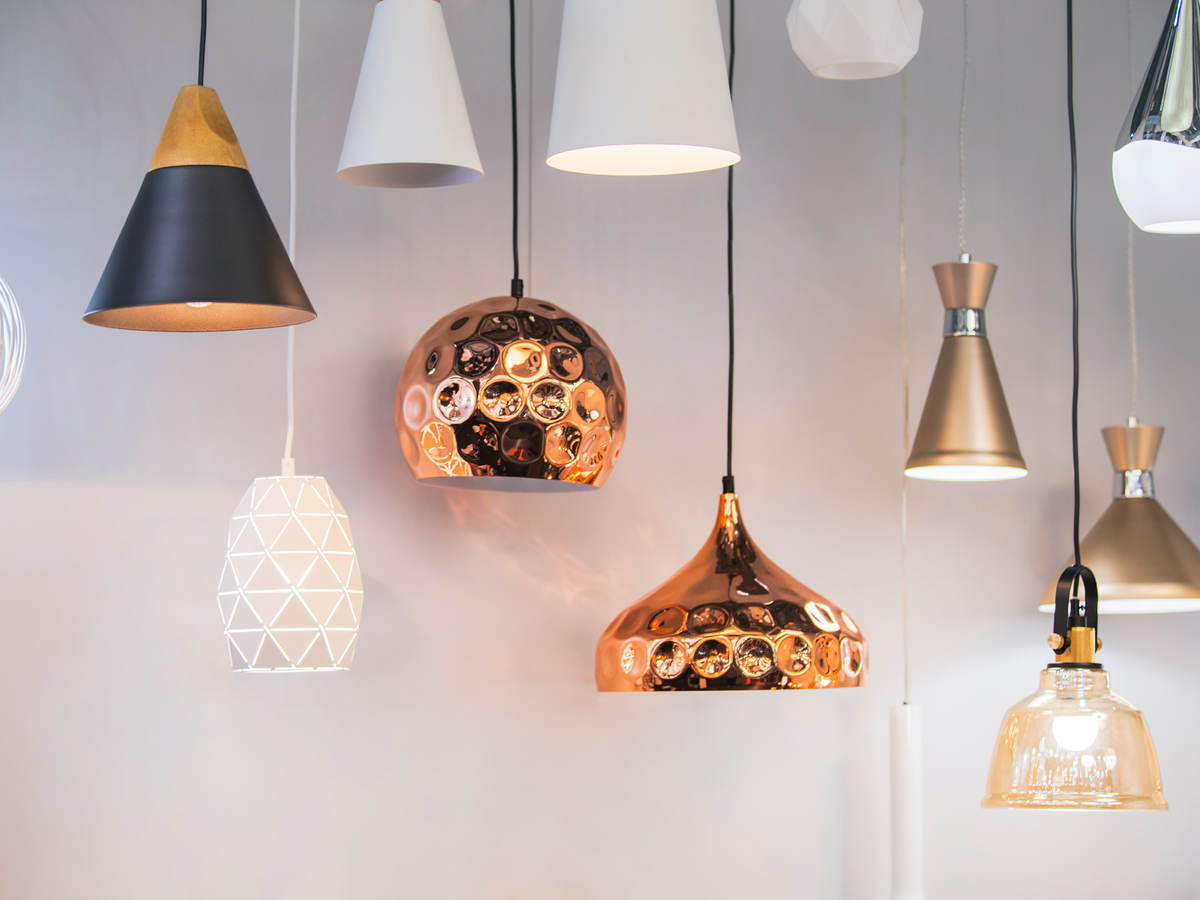 A variety of lighting fixtures hanging together in a retail setting.
