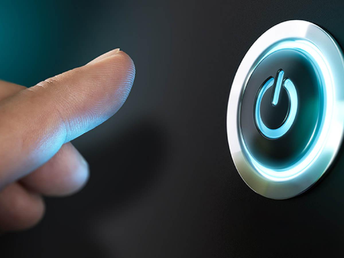 Finger on power button