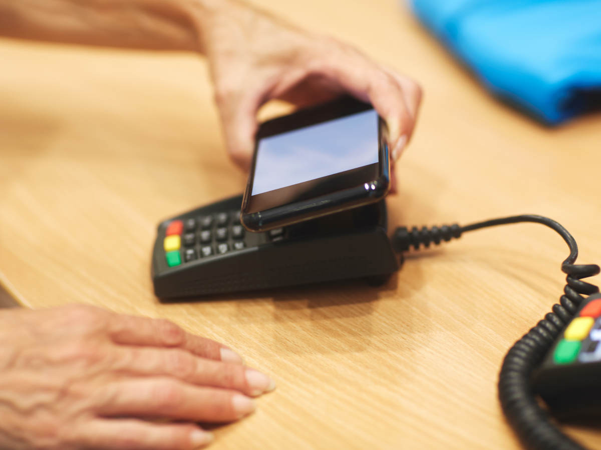 man tapping a mobile phone for payment