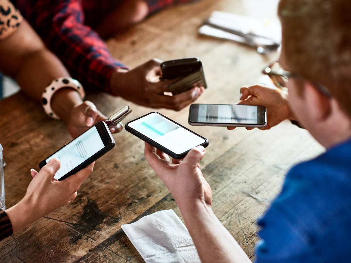 people sharing information by mobile phones