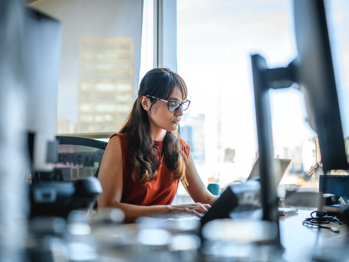 businesswoman using a laptop computer at office