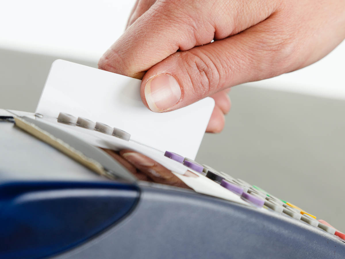 man swiping a credit card for payment