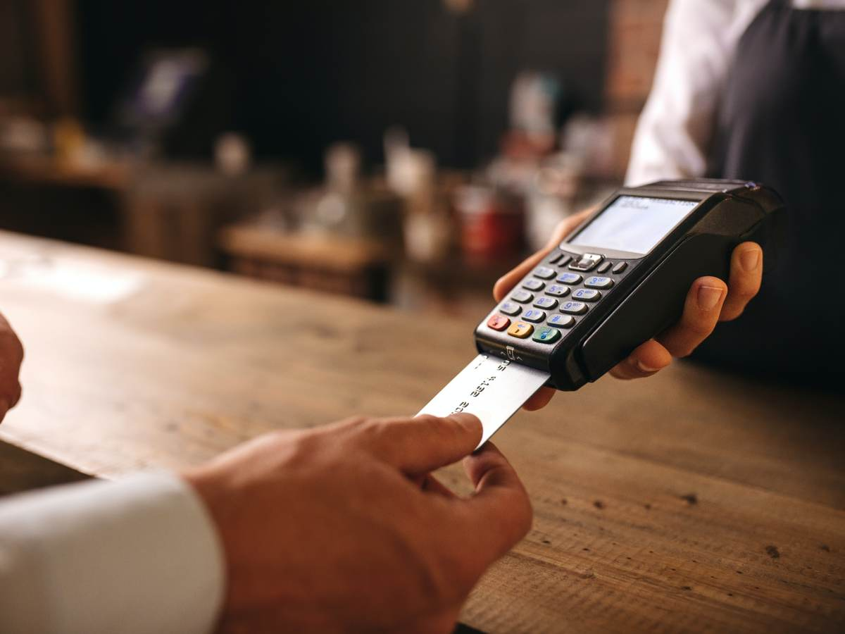 customer doing payment with a credit card in cafe