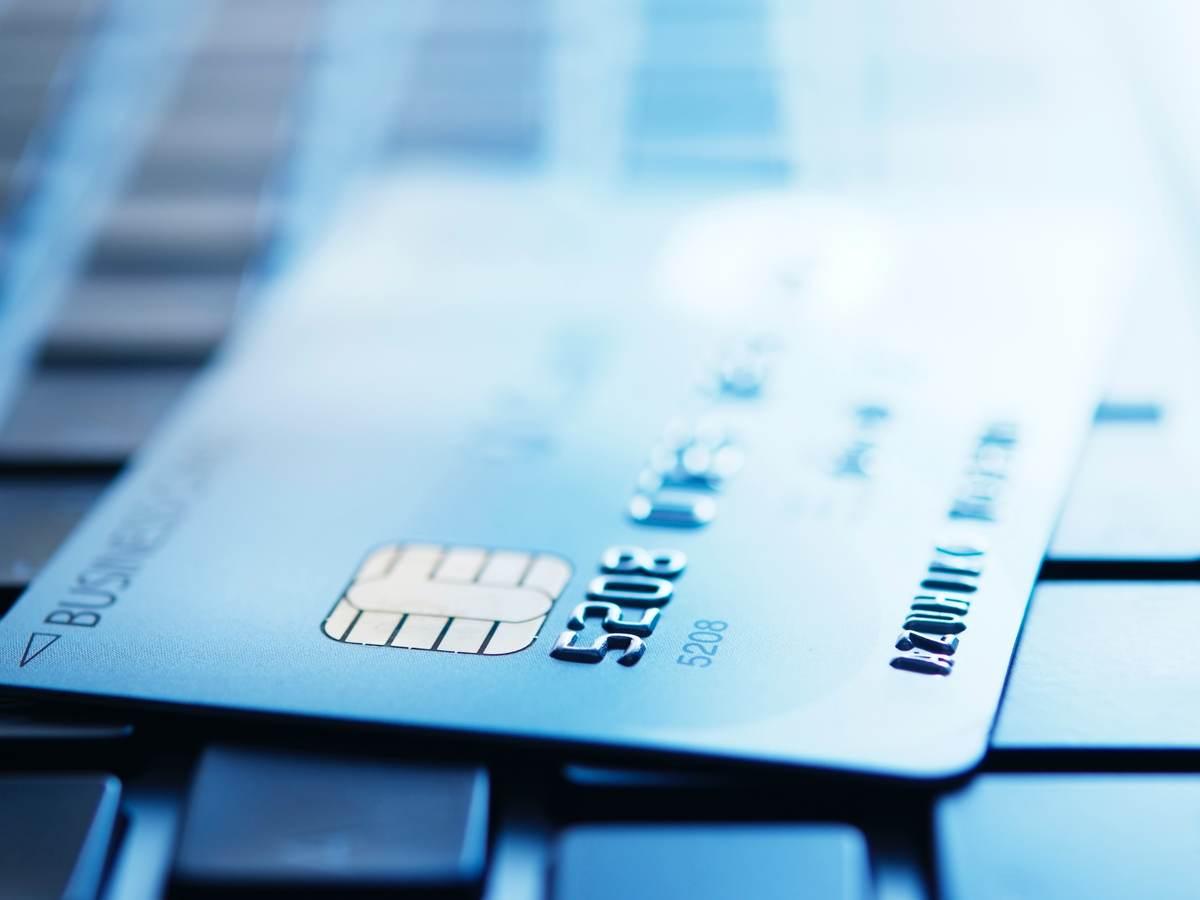 a credit card on a keyboard
