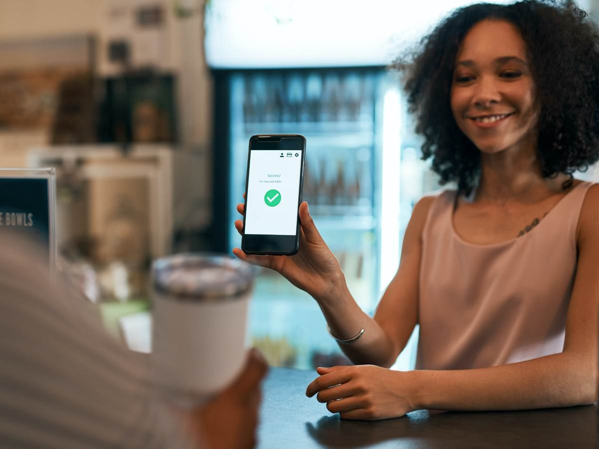 woman holding a mobile phone for payment